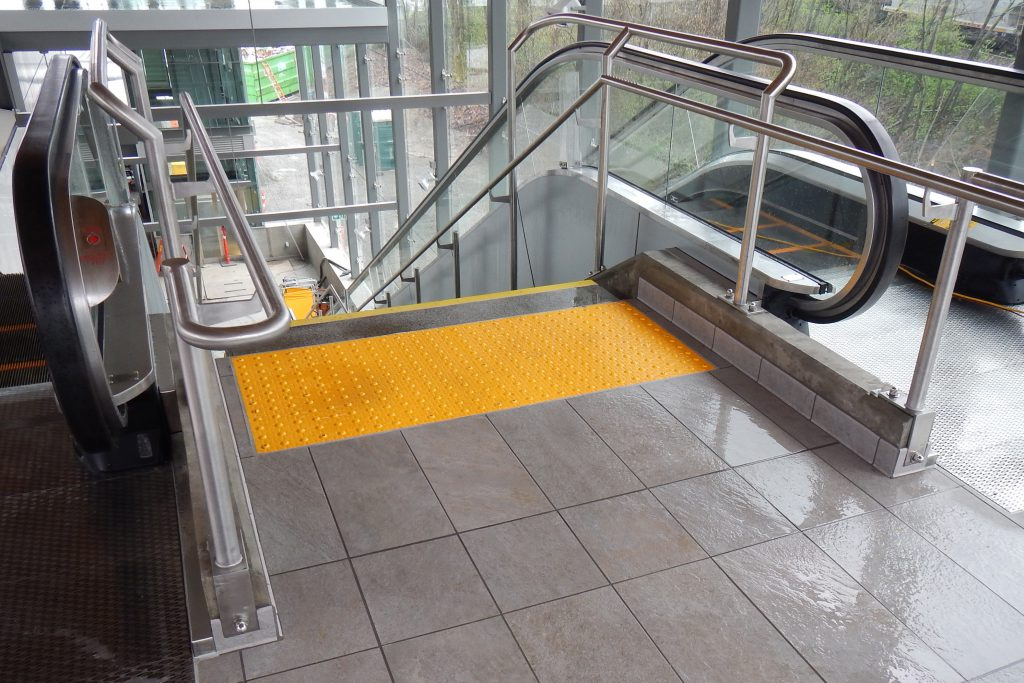 Surface Applied Tile at Evergreen Line Stairs